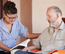 caregiver reading story to the patient